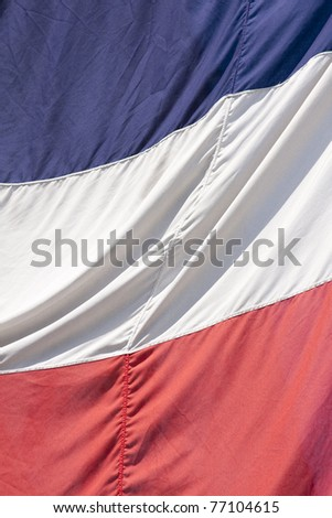 Frame filling shot of the French flag on a bright and sunny day - stock photo