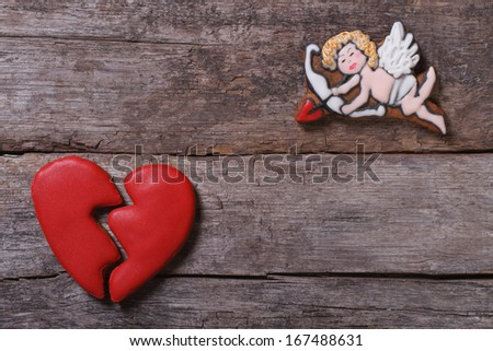 Frame for Valentine's Day. Biscuits Cupid and a broken heart - stock photo