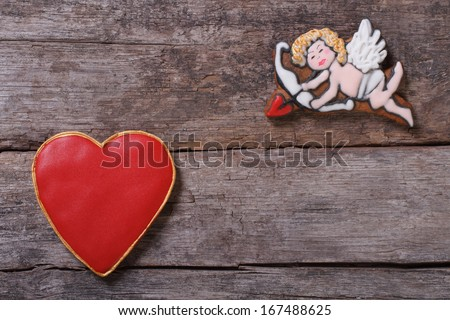Frame for Valentine's Day. Cupid shoots arrows at hearts. composition of cookies - stock photo