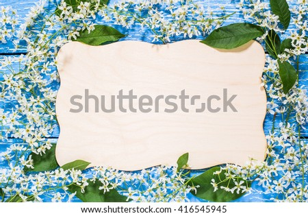Frame from blooming branches of bird cherry tree with space for text. Can be used as floral backgrounds, holiday greetings and invitations postcards - stock photo
