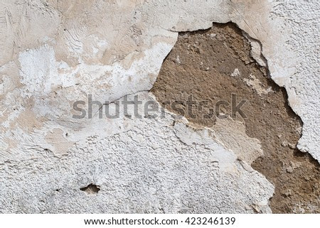 Frame from the destroyed plaster on  house wall , close up - stock photo