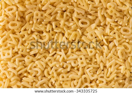 Frame full of alphabet noodles or alphabet pasta. - stock photo