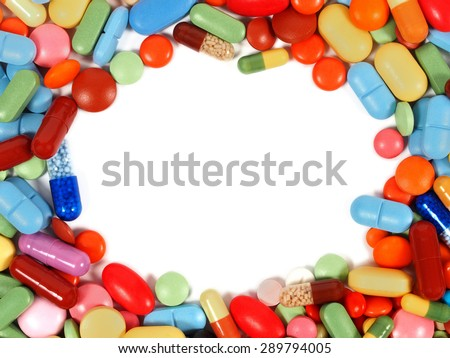 Frame made from pills with round copy space inside - stock photo