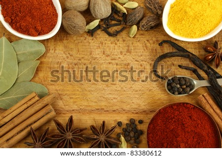 Frame made of different spices - cinnamon, star anise, nutmeg - stock photo