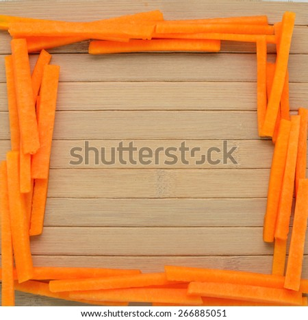 frame made of pieces of pumpkin on the wooden table  with space for text - stock photo