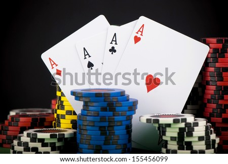 frame made of playing cards and poker chips on black background close-up - stock photo