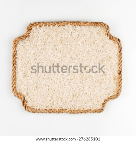 Frame made of rope with rice lying on a white background, with place for your text, graphics  - stock photo
