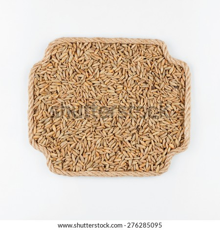 Frame made of rope with rye  lying on a white background, with place for your text, graphics