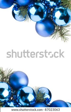 frame made with bright blue christmas baubles in vertical composition