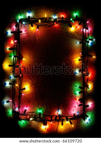 Frame made with Christmas tree colorful lights on black background