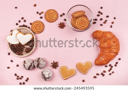 Frame made with cookies, croissant, coffee beans and cup of coffee - stock photo