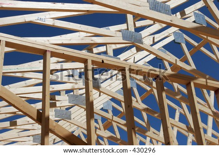 frame of a new house under construction - stock photo