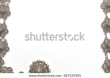 Frame of belt with silver flowers isolate on white ,thailand
