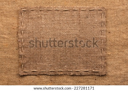 Frame of burlap, lies on a background of burlap, with place for your text - stock photo