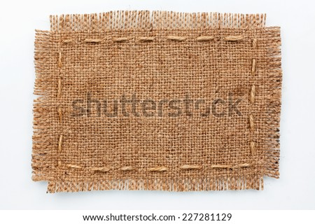 Frame of burlap, lies on a background of burlap  with place for your text,on a white background  - stock photo