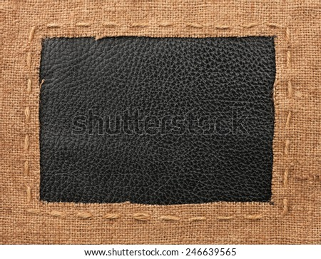Frame of burlap, lies on a background of leather, with place for your text