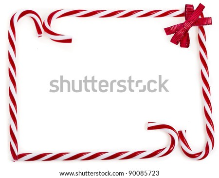 frame of christmas lollipop cane isolated on white - stock photo