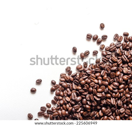 Frame of coffee beans and white background with area for copy space. - stock photo