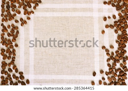 Frame of coffee beans on color sackcloth background - stock photo