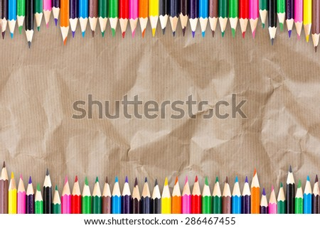 Frame of Colour pencils with shadow on Recycle Cardboard Texture Paper background - stock photo