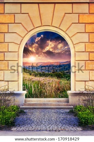 Frame of desolate immured door with picture of mountain meadow on sunrise and steps of cut stone - stock photo
