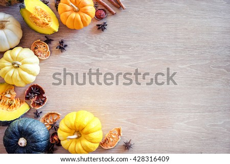 Frame of  fresh colorful pumpkins on the wooden table. Top view. Flat lay. - stock photo