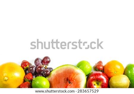 Frame of fresh fruits on white background - stock photo