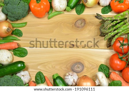 Frame of fresh vegetables on a wooden table - stock photo