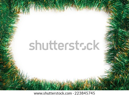 Frame of green Christmas garland on a white background - stock photo
