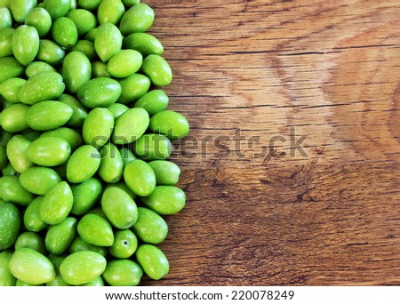 Frame of green olives - stock photo