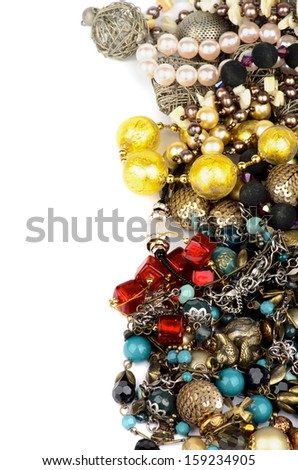 Frame of Jewelry with Gold Bracelets, Ruby Necklace, Pearl and Gem Beads isolated on white background - stock photo