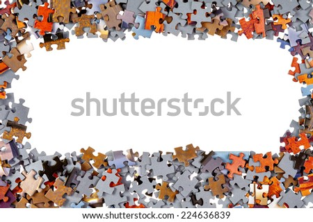 Frame of jigsaw puzzle pieces isolated over white background - stock photo