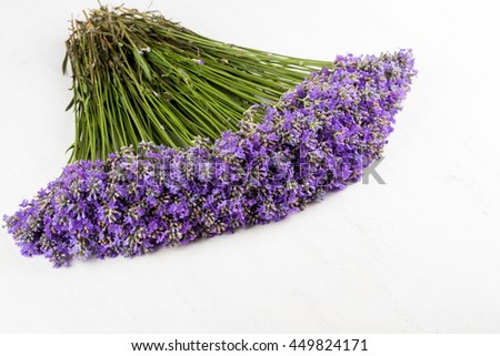frame of lavender on a white wooden background - selective focus, copy space