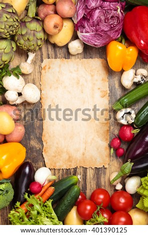 Frame of mixed organic vegetables and herbs on old wooden background.  - stock photo