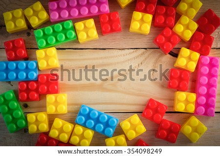 frame of pile plastic toy blocks with copy space - stock photo