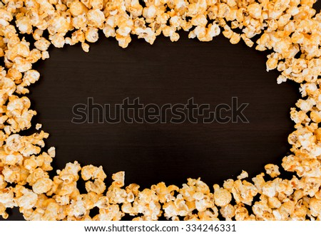 frame of popcorn on black background.
