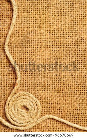 frame of ropes Roll on sack - stock photo