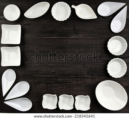 Frame of Several Sauce boat on black wooden rustic surface background - stock photo