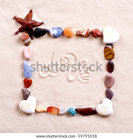 frame of shells in sand as a background - stock photo
