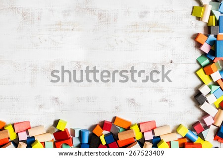 Frame of toy colored wooden bricks - stock photo