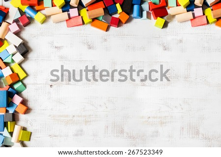 Frame of toy colored wooden bricks background - stock photo