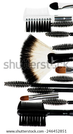 Frame of Various Make-up Brushes and Applicators closeup on white background - stock photo