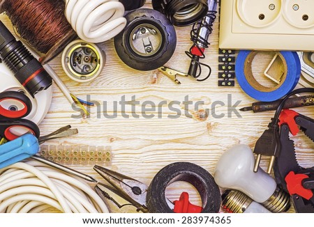 Frame tool electrician on a wooden background - stock photo