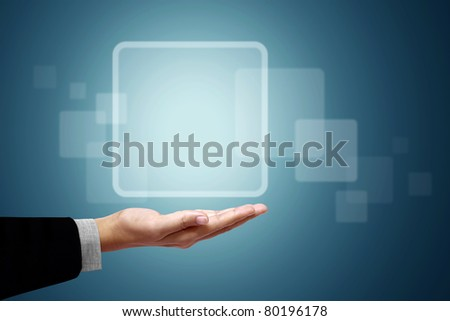 Frame white square above the business hand on a blue background. - stock photo