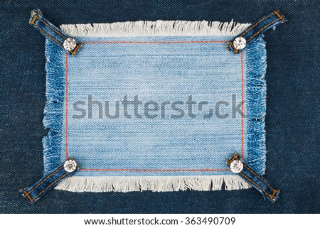 Frame with four straps jeans and rhinestones, lies on the dark denim, with space for your text - stock photo