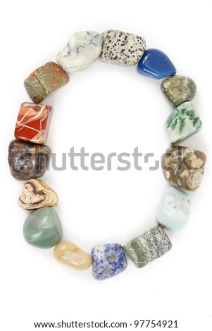 frame with mineral stones on a white background - stock photo