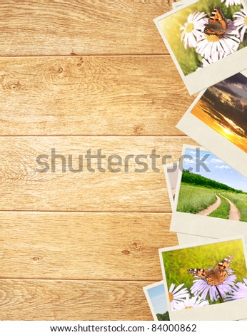 Frame with old photos. Objects over wooden planks