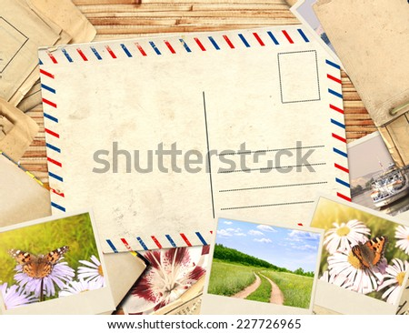 Frame with old postcard and photos - stock photo