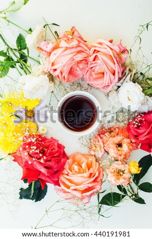 frame with pink roses, branches, leaves  isolated on white background. Flowers background. Roses on a white  tablecloth. overhead view.  - stock photo