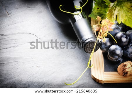 Frame with red wine bottle and fresh grape - stock photo